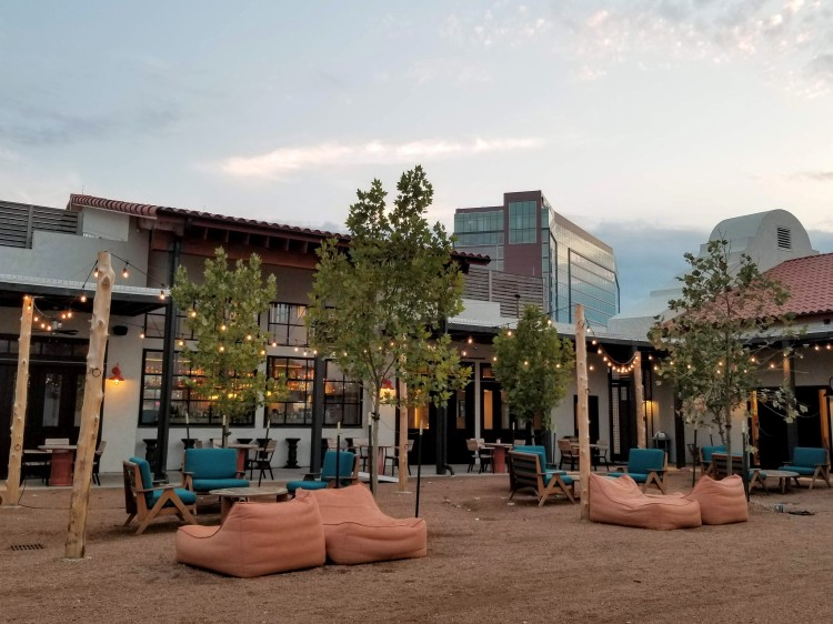 Outdoor seating by Two Mules Cantina at Texican Court