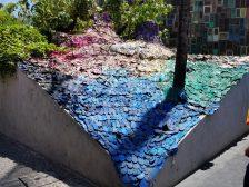 Art display outside of the Potato Head Club in Seminyak showing 5,000 plastic sandals that have washed up on shore.