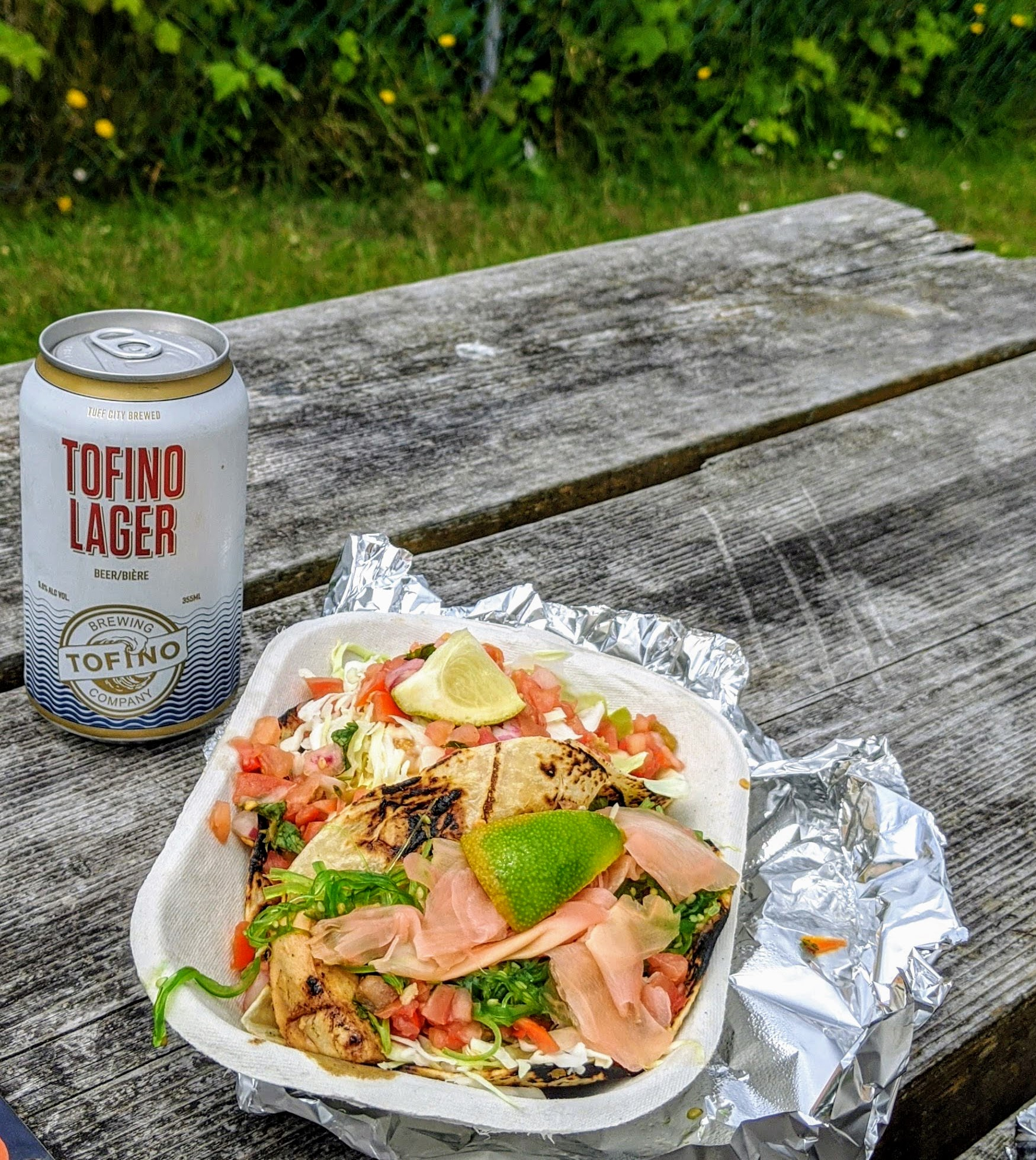 Enjoying tacos from Tacofino in Tofino