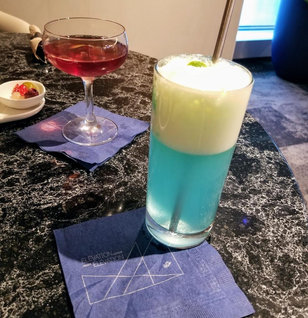 YYC WestJet Elevation Lounge: WestJet Elevation cocktail (right) and Holorime (left)