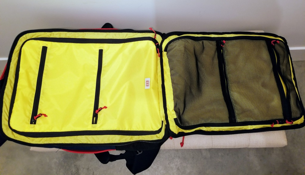 Topo Designs 40L Travel Bags: this compartment is good for storing books, toiletries, electronics, and chargers