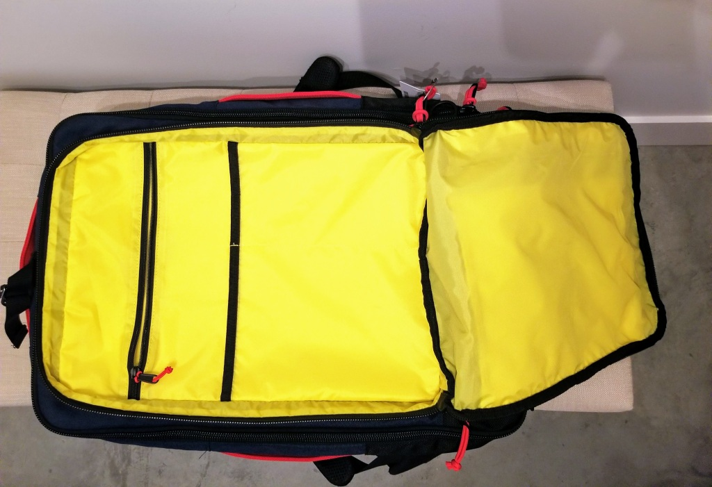 Topo Designs 40L Travel Bags: this compartment is good for storing documents and thin items