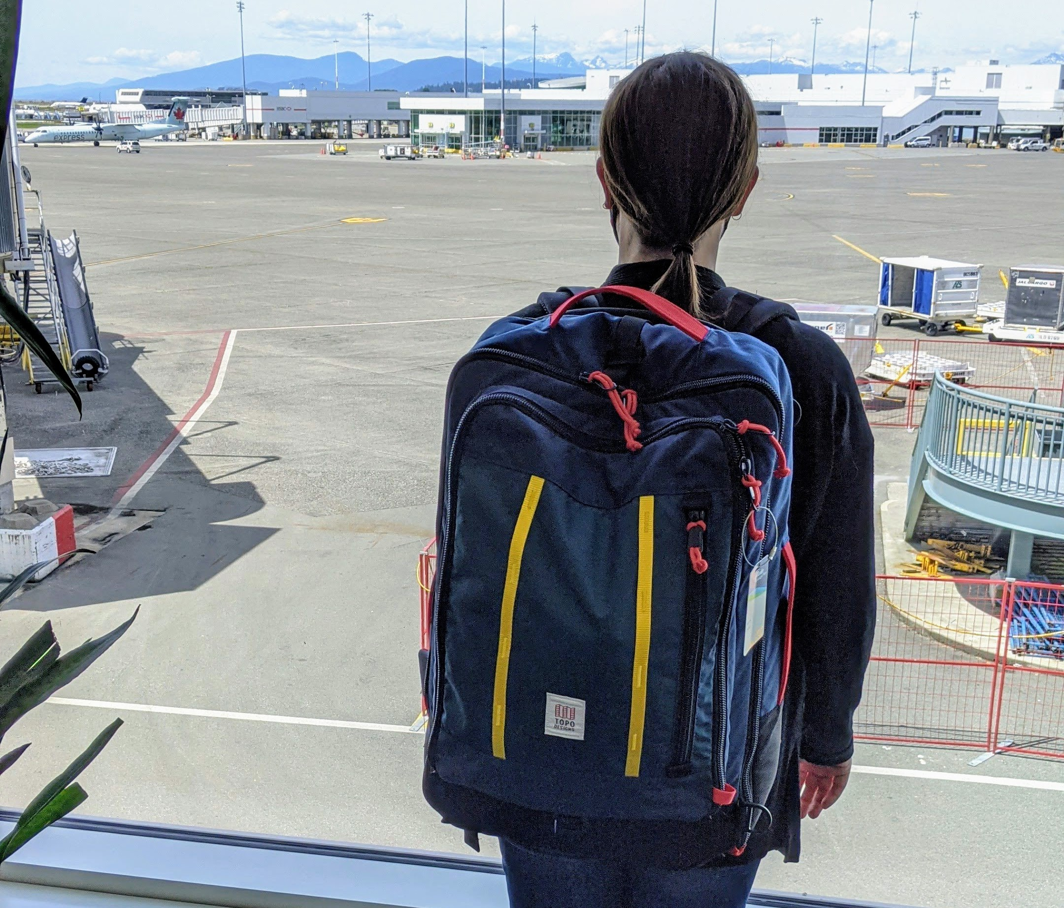 Max ready to test out the Topo Designs bag on a flight