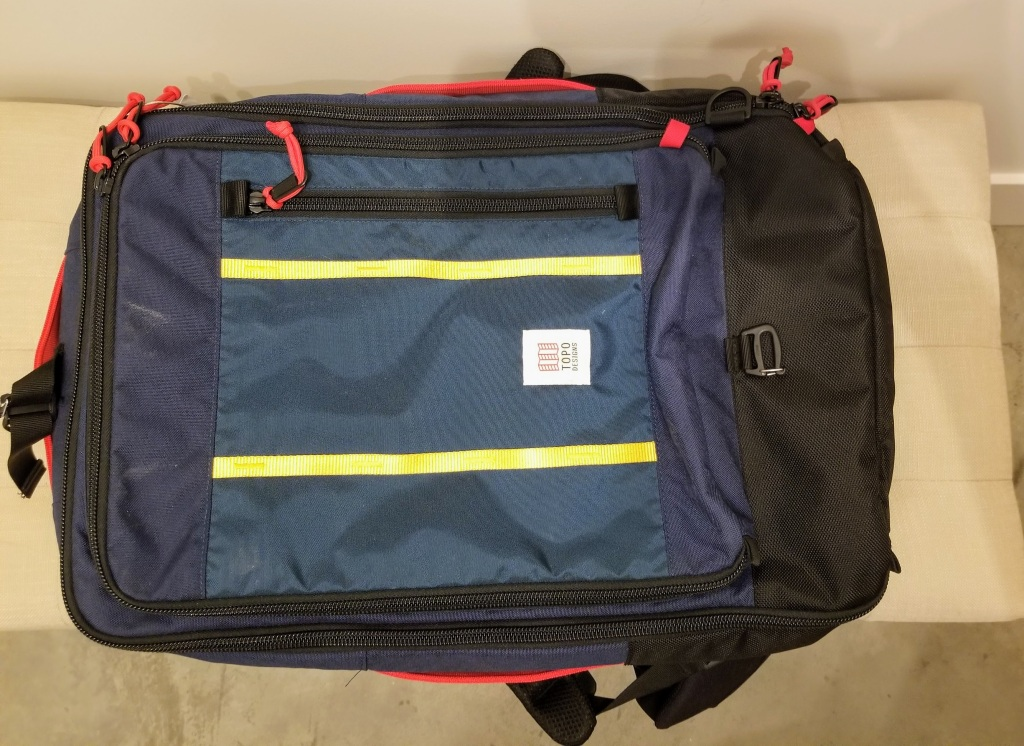 Topo Designs 40L Travel Bags: the exterior of the bag also has a small pocket to store keys and documents like passports for easy access in transit