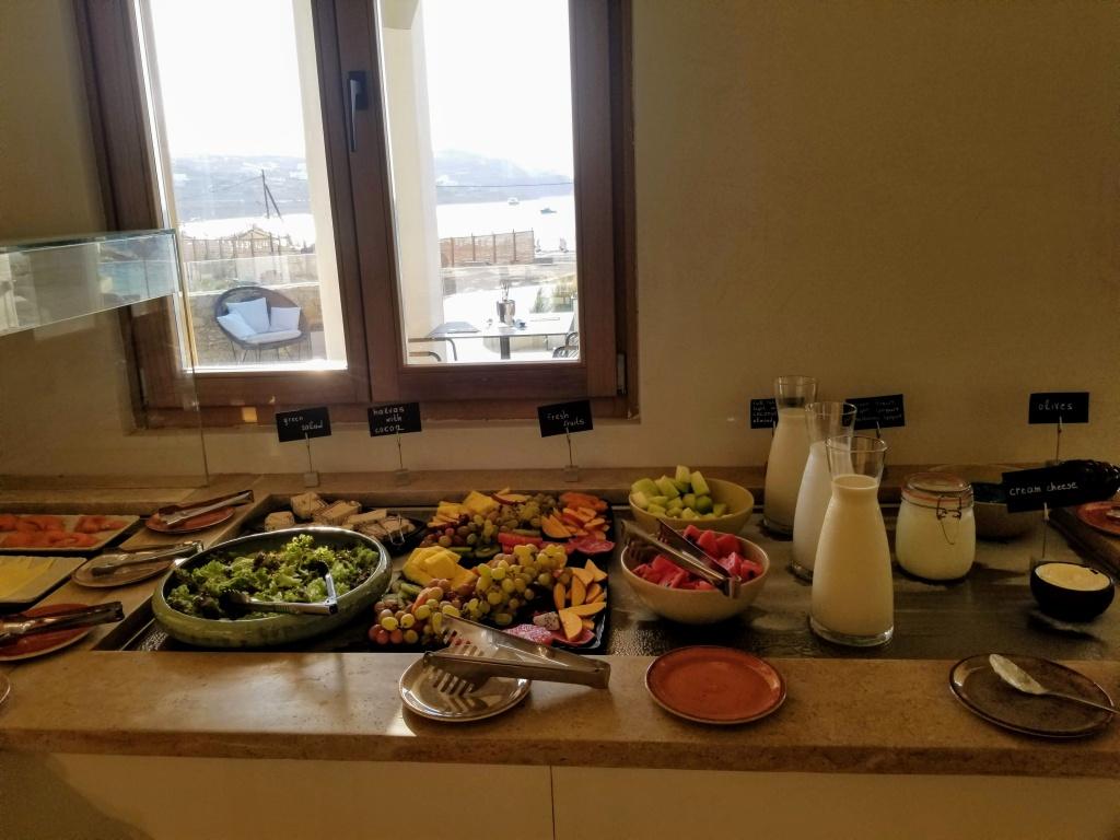 Aegon Mykonos: Breakfast buffet options like salad, fruit, milk and yogurt