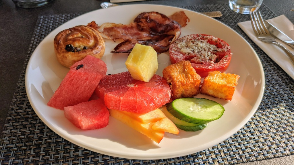 Aegon Mykonos: Some of the items from the breakfast buffet; fruit, veggies, pastry, honey sesame halloumi, bacon
