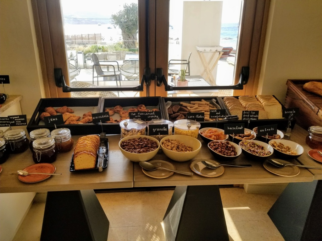 Aegon Mykonos: Breakfast buffet options like breads, pastries and cereal