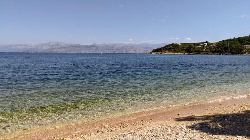 A beach near Kassiopi with Albania in the distance