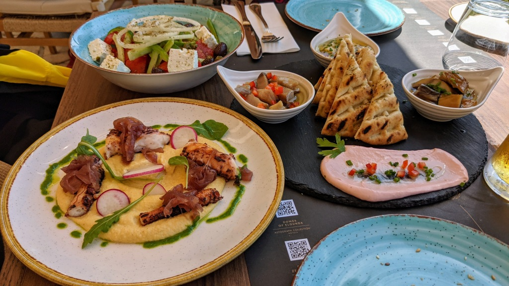 Lunch at Domes of Corfu: grilled octopus with fava beans, Greek salad, and seafood sampler of cured fish and dips