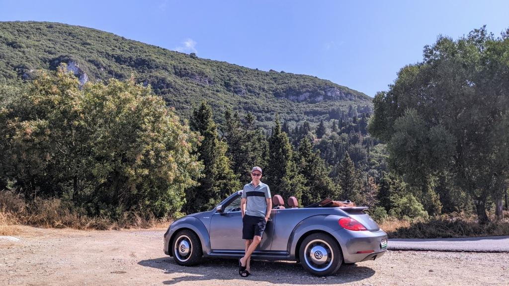 Jason with the car in the hills of Corfu
