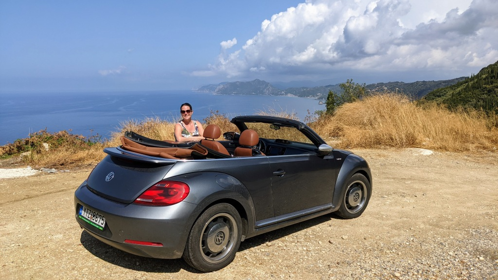 Max with the car in the hills of Corfu
