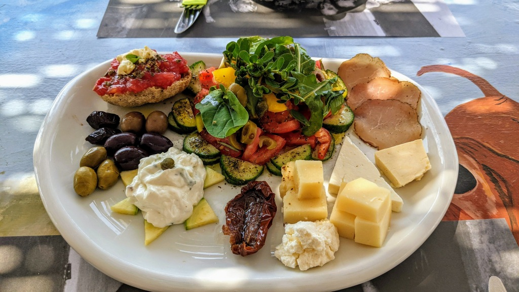 Vioma Organic Farm and Vineyard: Our meze plate with dakos, a salad, local cured meat, a selection of local cheese, olives and their amazing tzatziki