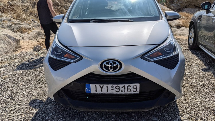 Inspecting our rental car, a Toyota Aygo...after looking for it all over the airport parking lot!